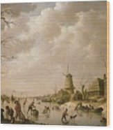 Skaters On A Frozen Canal Wood Print by Hendrik Willem Schweickardt