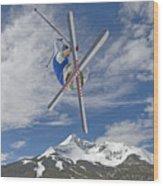 Skiing Aerial Maneuvers Off A Jump Wood Print by Gordon Wiltsie