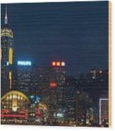 Skyline Illuminated At Night From Kowloon Wood Print by Sami Sarkis