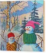 Snow Mom And Son Wood Print