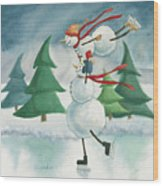 Snowmen Skating Wood Print