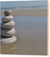 Stack Of Pebbles On Beach Wood Print
