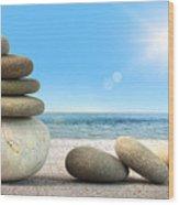 Stack Of Spa Rocks On Wood Against Blue Sky Wood Print