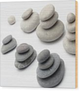 Stacks Of White And Gray Pebbles Wood Print