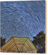 Star Trails Over The Umbrellas Wood Print