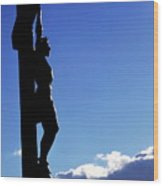 Statue Of Jesus Christ On The Cross Against A Cloudy Sky Wood Print