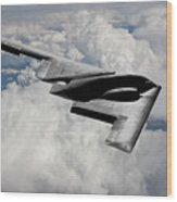 Stealth Bomber Over The Clouds Wood Print