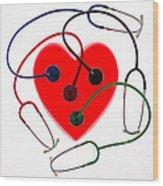 Stethoscopes And Plastic Heart Wood Print