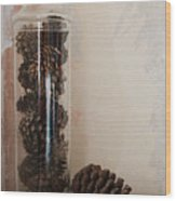 Still Life Of A Glass Jar Of Pine Cones Wood Print