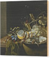 Still Life Of Hazelnuts Grapes Oysters And Other Foods On A Draped Table Wood Print