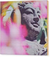 Stone Carved Statue Of Buddha Surrounded With Colorful Flowers Bali, Indonesia Wood Print