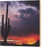 Storm Clouds Pass Over A Saguaro Catus Wood Print