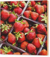 Strawberries With Green Weed In Plastic Containers  Wood Print