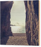 Sun Glinting Through A Cave At Bussaglia Beach In Corsica Wood Print