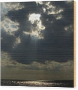 Sun Rays Pierce Through Clouds And Rest Wood Print