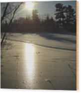 Sun Reflecting Off River Ice Wood Print