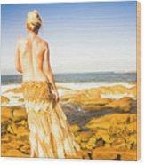 Sunbathing By The Sea Wood Print