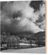 Sunlight Clouds And Snow In Black And White Wood Print