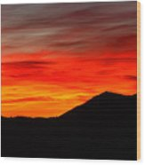 Sunrise Against Mountain Skyline Wood Print by Max Allen