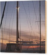 Sunset And Sailboat Wood Print