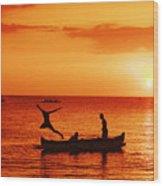 Sunset Canoe Jump Wood Print