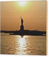 Sunset On Lady Liberty Wood Print