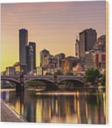 Sunset Over Skyscrapers Of Melbourne Downtown And Princes Bridge Wood Print