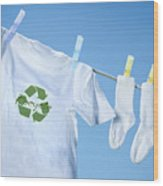 T-shirt With Recycle Logo Drying On Clothesline On A  Summer Day Wood Print