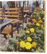 Tables And Chairs With Flowers Wood Print