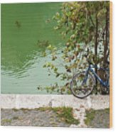 The Bicycle Is A Ubiquitous Form Of Transport In Europe And This Owner Has Literally Gone Fishing. Wood Print