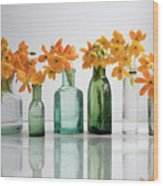 the Blooming yellow Ornithogalum Dubium in a transparent bottle instead vase Wood Print