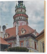 The Cesky Krumlov Castle Tower With A Fountain Below Within The Czech Republic Wood Print