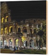 The Colosseum In Rome At Night Wood Print