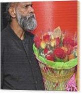 The Flower Vendor - Man Selling Roses Wood Print