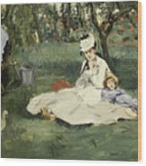 The Monet Family In Their Garden At Argenteuil Wood Print