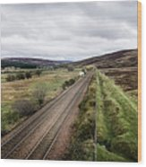 The Railroad To....in Scotland With Clouds Hanging Over The Mountains. Wood Print