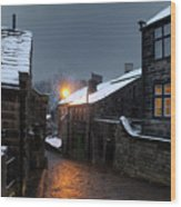 The Village Of Heptonstall In The Snow At Night With Lamps Shini Wood Print