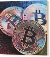 Three Bitcoin Coins In A Colorful Lighting. Wood Print