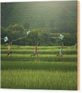 Three Boys Are Happy To Play Kites At Summer Field In Nature In  Wood Print