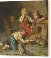 Three Children Feeding Rabbits Wood Print