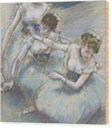 Three Dancers In A Diagonal Line On The Stage Wood Print