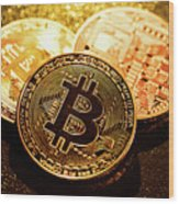 Three Golden Bitcoin Coins On Black Background. Wood Print