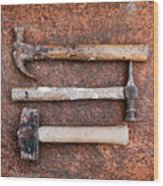 Three Hammers Against A Rust Background Wood Print