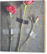 Three Red Flowers Taped To Wooden Background Wood Print