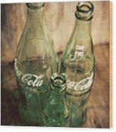 Three Vintage Coca Cola Bottles  Wood Print