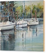 Three White Sails Docked Wood Print