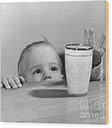 Toddler Reaching For Glass Of Milk Wood Print