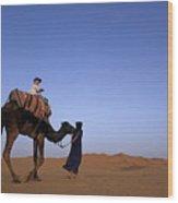 Touareg Man Leading Boy Riding Camel In Sahara Desert Wood Print