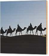 Tourists On Camels Along Top Of Erg Wood Print