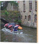 Tourists With Umbrellas In A Sightseeing Boat On The Canal In Bruges Wood Print